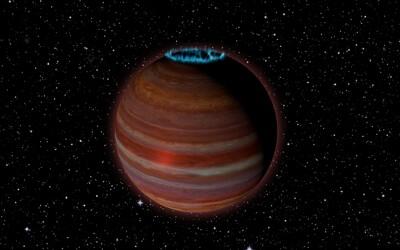 Galaxií se toulá neobvyklá osamělá planeta se zářivou aurou