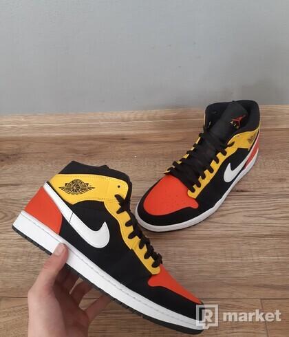 Jordan 1 Mid Black Amarillo Orange