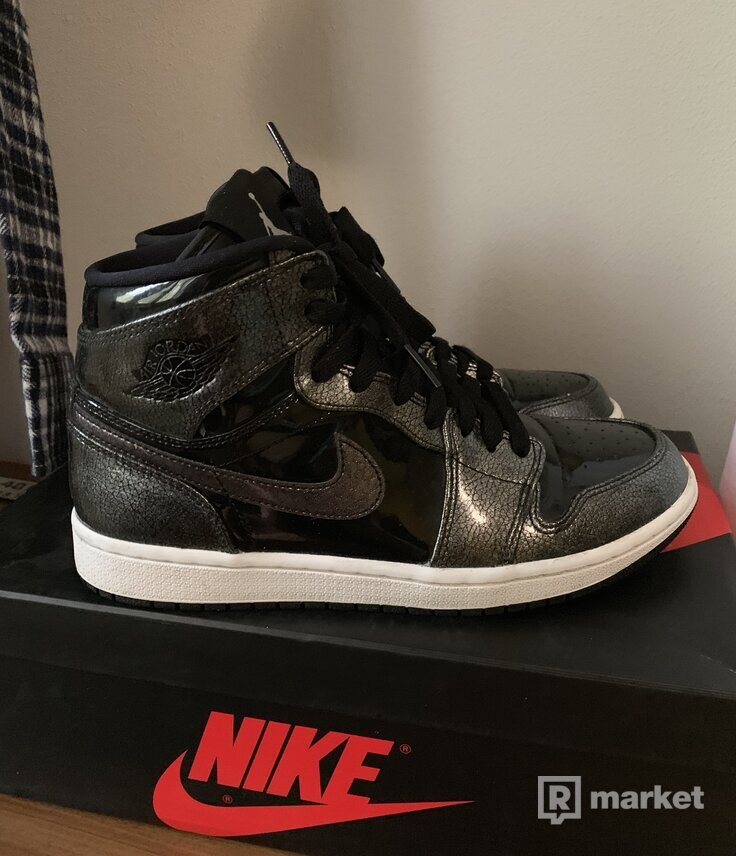 The Air Jordan 1 High Releases In Black Patent Leather
