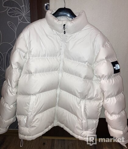 The North Face white nuptse jacket