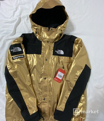 Supreme x tnf metallic gold parka